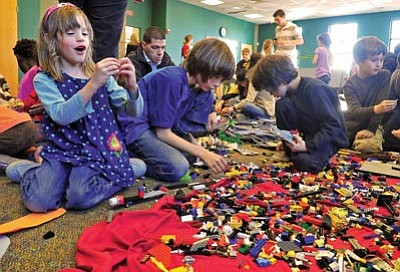 Matt Hinshaw/The Daily Courier<br /><br /><!-- 1upcrlf2 -->Kids work on building Lego cars, houses and airplanes Thursday afternoon during the Prescott Public Library's Lego Expo.