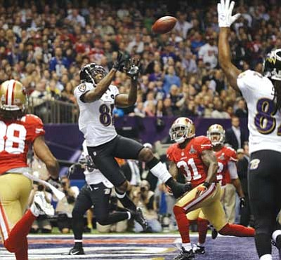 Matt Slocum/The Associated Press<br> Baltimore Ravens wide receiver Anquan Boldin catches a 13-yard touchdown pass.