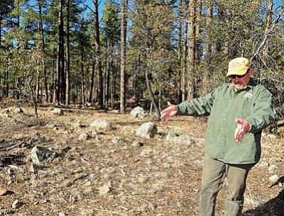 Matt Hinshaw/The Daily Courier<br> City of Prescott Parks and Recreation Director Joe Baynes describes some of the expansions that are in the works for Goldwater Lake Thursday afternoon. Here, Baynes points out the future site of a ramada at the mountain lake.