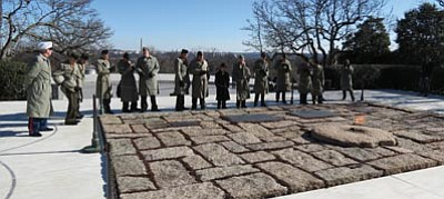 Courtesy the Central Arizona Young Marines<br>The Central Arizona Young Marines pay their respects at the John F. Kennedy Eternal Flame Presidential Memorial during their trip to Washington D.C. during Inauguration Week.