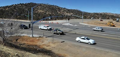 Matt Hinshaw/The Daily Courier<br>Construction crews work on the new tribal connector road in front of the Frontier Village shopping complex in Prescott Wednesday. The Yavpe Connector will open to the public Monday.