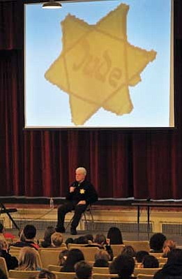 Matt Hinshaw/The Daily Courier<br> Auschwitz survivor and Hungarian native Stephen Nasser talks with Prescott Mile High Middle School students about the Holocaust, Thursday afternoon in Prescott. Nasser lost most of his family at the hands of Nazis when he was just 13.