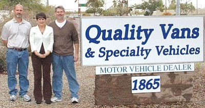 Courtesy photo<br>Gary Reber, his sister-in-law Vicki and his brother Doug stand in front of the sign for their business, Quality Vans & Specialty Vehicles in Tempe. The Arizona Small Business Development Center Network recently announced Quality Vans will receive a 2013 Success Award at a luncheon March 18.