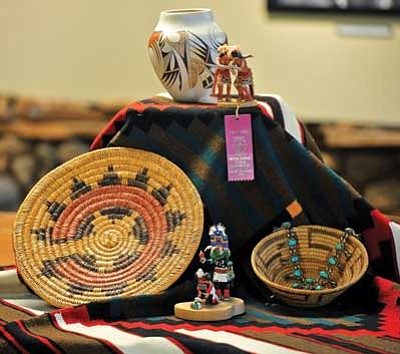 Matt Hinshaw/The Daily Courier<br /><br /><!-- 1upcrlf2 -->An Apache basket, a Tohono O'odham basket, Hopi kachinas and a Navajo contemporary chief blanket are only a few of the items that will be available during the annual Smoki Museum Spring Indian Art and Navajo Rug Auction.  <br /><br /><!-- 1upcrlf2 -->