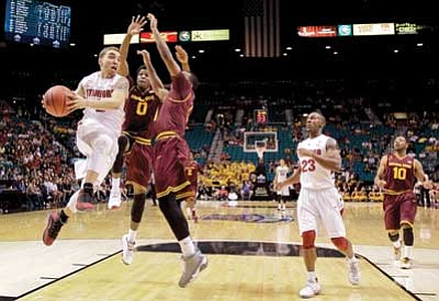 Julie Jacobson/The Associated Press<br> Stanford's Aaron Bright drives to the basket against Arizona State's Carrick Felix and Jahii Carson in their Pac-12 tournament game Wednesday in Las Vegas. Arizona State won 89-88 in overtime.