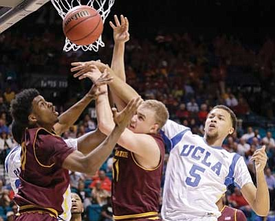 Julie Jacobson/The Associated Press<br> ASU's Carrick Felix and Jonathan Gilling battle for a rebound against UCLA's Kyle Anderson on Thursday in Las Vegas.