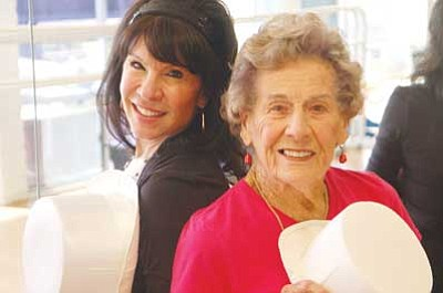 Patrick Whitehurst/The Daily Courier<br> Summer's DanceWorks Owner and Instructor Summer Hinton, left, poses in her studio with 90-year-old tap dancer Sue Chambers. Chambers said she doesn't believe age should stop anyone from learning something new, even something as physical as dance.
