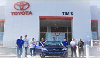 Courtesy photo<br> Helping raise money for Badger baseball are, from left, senior varsity Badger baseball players Matt Fine, Tyler Eder, Coach John Irish, Cade Jacobs, Austin Barrett, Tim's Auto Group Used Car Manager Robby Hinshaw and Tim's Auto Group GM Ali Hussain.