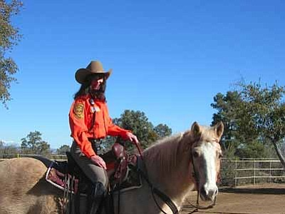 Courtesy Photo<br> Carol (last name withheld per request) and her trusty horse Sequel are ready for a Search and Rescue operation as part of the Yavapai County Sheriff's Response Team's Mounted Unit.