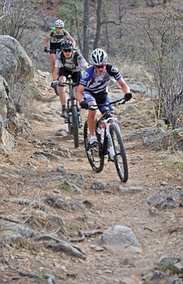 Matt Hinshaw/The Daily Courier<br>Andrew Myrick, 14, Jared Samuelson, 17, and Will Hughes, 15, train together Wednesday afternoon on the Thumb Butte Trail in Prescott. The three Mountain Bike Association of Arizona riders compete in races together across the state.