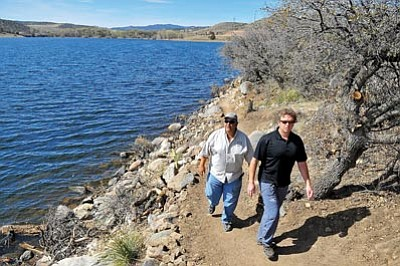 Matt Hinshaw/The Daily Courier<br>City of Prescott trail specialist Chris Hosking and Parks and Recreation assistant superintendent Steve Mancha hike the new Lakeshore/Fishing Trail at Watson Lake Thursday morning in Prescott.