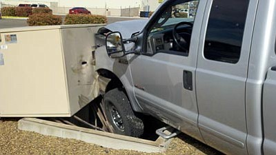 Courtesy Prescott Valley Police<br /><br /><!-- 1upcrlf2 -->Two vehicles that collided Monday afternoon at the intersection of 2nd and 5th streets in Prescott Valley damaged power boxes, causes power outages to nearby businesses. <br /><br /><!-- 1upcrlf2 -->
