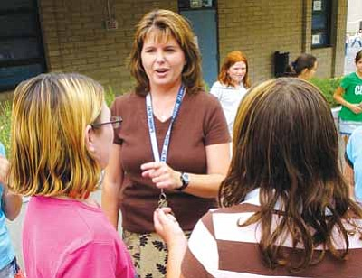Les Stukenberg/The Daily Courier<br> Newly appointed Prescott High School Principal Stephanie Hillig talks to students at Granite Mountain Middle School.