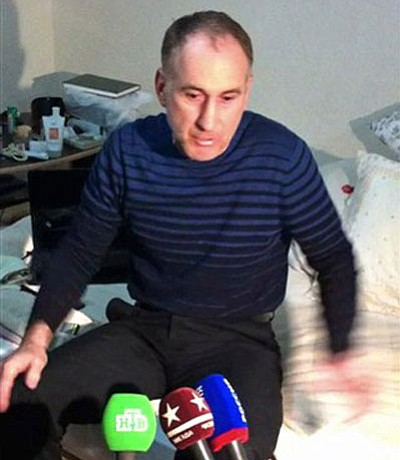 In this image taken from a mobile phone video, the father of USA Boston bomb suspects, Anzor Tsaraev reacts as he talks to the media about his sons, in his home in the Russian city of Makhachkala, Friday April 19, 2013. One son is now dead, and one son Dzhokhar Tsaraev is still at large on Friday suspected in Monday's deadly Boston Marathon bombing which stunned friends who have pleaded for the surviving brother, described as bright and outgoing young man, to turn himself in and not hurt anyone.(AP Photo)