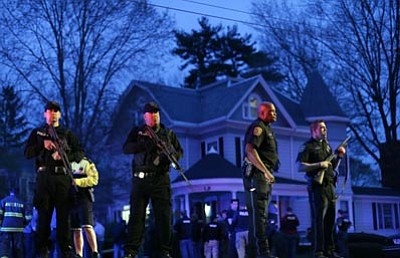 Matt Rourke/The Associated Press<br> Police officers guard the entrance to Franklin street where there is an active crime scene search for the suspect in the Boston Marathon bombings, Friday in Watertown, Mass.