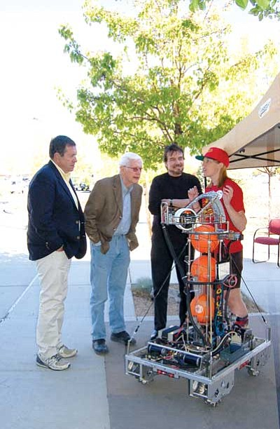 "Patrick Whitehurst/The Daily Courier<br> ""Star Trek"" actors David Frankham, Barry Jenner and Sean David Kenney watch a robotics demonstration. Saturday. The robot, capable of shooting baskets, and the actors were all on hand for the Prescott Film Festival's Sci-Fi Mini Fest. The fest features a number of science fiction films, workshops and celebrity visits."