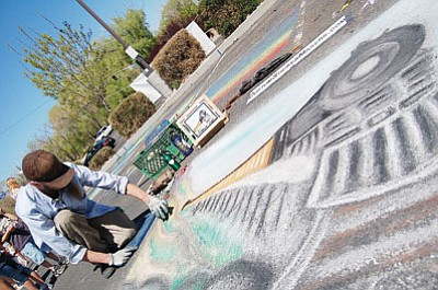 """Patrick Whitehurst/ The Daily Courier<br> Prescott artist Jeff Daverman works on a chalk piece titled """"The Train,"""" dedicated to his grandfather, who worked as a chalk artist for 60 years."""