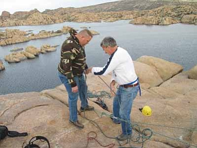 Veterans Action Leadership Project/Courtesy photo<br> Veterans Action Leadership Project Executive Director Tom Whittaker, right, helps an Army veteran prepare to rappel at Watson Lake in March of this year.