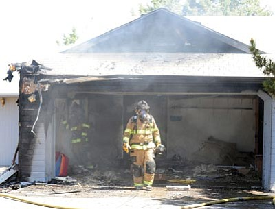 Les Stukenberg/The Daily Courier<br>Central Yavapai firefighters put out a fire in the 7200 block of Pioneer Lane in Prescott Valley Tuesday morning.