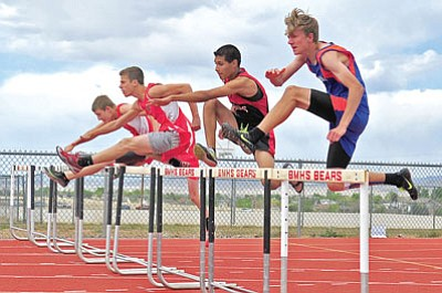 Matt Hinshaw/The Daily Courier<br>Chino Valley's Kris Brix, right, and other county school runners leap over the first hurdle at the start of the boys' 110m hurdles event Friday afternoon during the Yavapai County Track meet in Prescott Valley.
