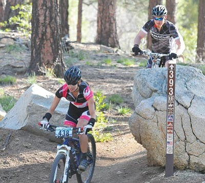 Les Stukenberg/The Daily Courier<br>Angie Bell cuts between two boulders on the Cold Springs Trail in the Prescott National Forest at last year's Whiskey Off-Road race.