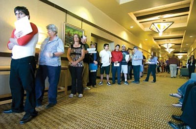 Les Stukenberg/The Daily Courier<br>More than 100 people wait in line to interview with some of the 40 employers who were accepting applications at Goodwill Industries' second annual job fair at the Prescott Resort Thursday morning.