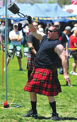 """Courier file<br>When people think of Highland Games, they usually envision """"men in skirts throwing telephone poles,"""" said Jill Nelson, president of the Prescott Area Celtic Society."""