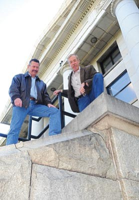 Les Stukenberg/The Daily Courier<br> Yavapai County Facilities Director Kenny Van Keuren and YC Supervisor Tom Thurman look at some of the cracking on the granite base stones along the western edge of the courthouse Thursday morning.