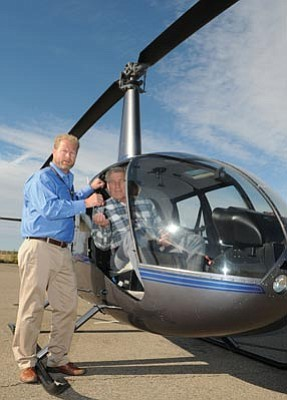 Les Stukenberg/The Daily Courier<br>John Stonecipher, left, president and CEO of Guidance Aviation Inc., presents the keys to a Robinson R44 Raven II helicopter to Yavapai County Sheriff Steve Waugh Oct. 7, 2010. Guidance Aviation donated the helicopter to YCSO.