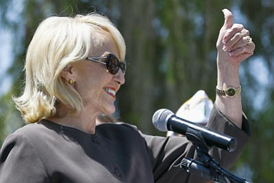 Ross D. Franklin/The Associated Press<br> Arizona Gov. Jan Brewer gives a thumbs up to hundreds of supporters as she touts her Medicaid expansion plan during a rally Wednesday in Phoenix.