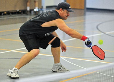 Matt Hinshaw/The Daily Courier<br>Damon Olsen (top photo) and Kevin Wente return the ball Saturday morning during the championship match of Prescott's first pickle ball tournament at the Willow Hills Baptist Church gym in Prescott.