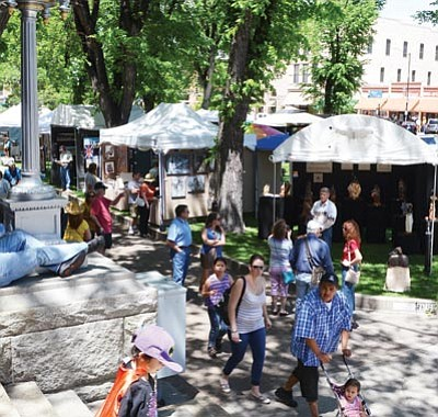 Patrick Whitehurst/The Daily Courier<br> Crowds buzz around downtown Prescott's courthouse square Saturday for the Phippen Museum's annual Western Art Show, Sale & Auction.