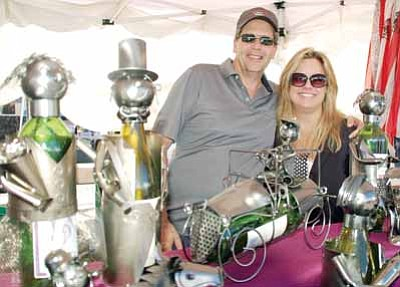 Patrick Whitehurst/The Daily Courier<br> Tom and Teresa Hamilton, and a number of their character bottle holders, took part in the annual Prescott Offstreet Festival, featuring retail vendors, art and food. The Prescott Chamber of Commerce puts on the event.