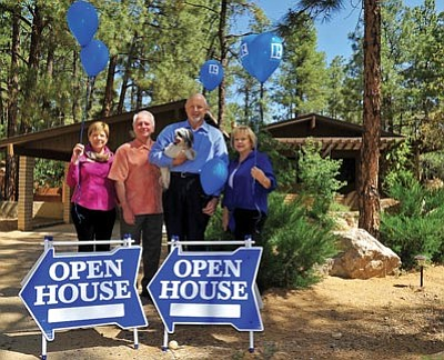 Matt Hinshaw/The Daily Courier<br>Prescott Area Association of Realtors Treasurer Joan Petty, President-Elect Pete Weaver, 2013 President Ed Pattermann, and Association Executive Karla Roberts pose in front of a home in the Mountain Club that is one of 115 Prescott-area homes that will be part of the Open House Weekend this Saturday and Sunday.