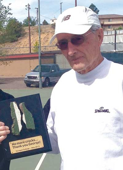 Lori Youngdahl/Courtesy photo<br> George Reynolds gets a plaque for his tireless efforts on behalf of repairing the cracks at the Yavapai College tennis courts in Prescott.