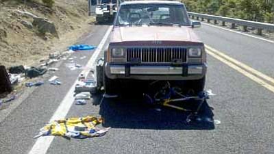 Courtesy Conrad Jackson/Prescott Fire Department<br> The scene of a collision Monday morning involving a bicycle and car. DPS investigators say the driver fell asleep at the wheel.