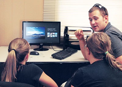 Courtesy photo<br>North-Aire Flight Instructor Rodney Evans explains cloud formations and what they tell pilots about the weather to two members of the Girl Scouts' Discover Aviation Camp Monday afternoon.