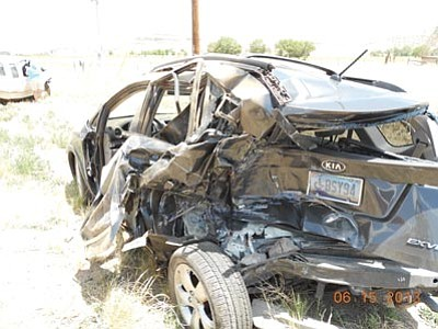 Courtesy photo<br>The driver of this 2008 Kia suffered non-life-threatening injuries and was flown to Flagstaff Medical Center after being hit by a truck carrying a horse.