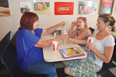 Karen Despain/The Daily Courier <br>  Marrietta Dzukowski, left, with her daughter Andrea Watson and granddaughter Nevaeh Watson, enjoy milk shakes at Kendall's Famous Burgers & Ice Cream in Prescott on Thursday.