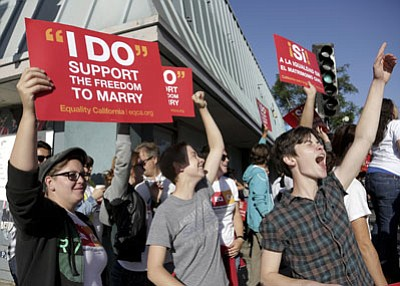 Jason Redmond/The Associated Press<br> Equity California members, from left, Geneya Terlouw, Mary Zeiser, and Bella Week, celebrate on Santa Monica Boulevard after the Supreme Court rulings on California Proposition 8 and the Defense of Marriage Act in West Hollywood, Calif., Wednesday.