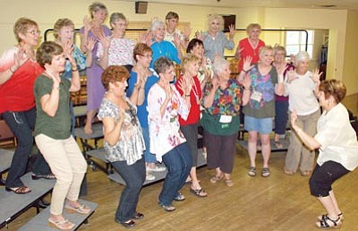 Laurel Bailey/Courtesy photo<br>The Song of the Pines Chorus, which is affiliated with Sweet Adelines International, practices for its July 6 and 7 performances celebrating its 50 years of harmony in Prescott. The performances will be at the Prescott Center for the Arts.