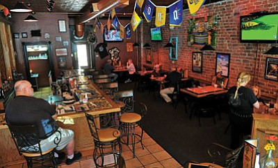 Matt Hinshaw/The Daily Courier<br> Above, Patrons begin to fill the El Charro Restaurant's Cantina Manana for lunch. Below, Owners Amanda and Gary Denny display some of their favorites, a Baja Stuffed Relleno, Grilled Fish Tacos, and a Shrimp stuffed Avacado along with a Fresh Peach, Black Berry and Mint, and a Jumbo Coronaita margaritas.
