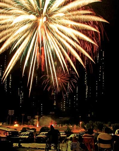 The Daily Courier, file<br> Fireworks rain down on the annual show in Prescott Valley.