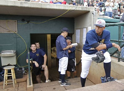 Chuck Burton/The Associated Press<br>Alex Rodriguez waits to take the field before his first rehab game with the Charleston RiverDogs in Charleston, S.C., on Tuesday.