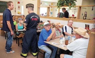 Les Stukenberg/The Daily Courier<br> Patrons take in the BackBurner Family Restaurant's dining room, which seats 85.