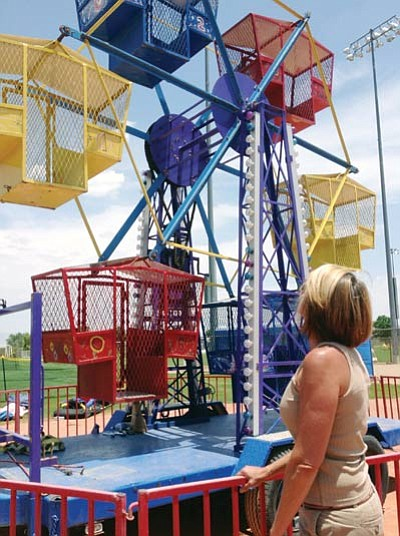 Patrick Whitehurst/The Daily Courier<br> City of Prescott Special Events Manager Becky Karcie, pictured looking over carnival attractions on July 3, said the Fourth of July celebration at Pioneer Park in Prescott will proceed as planned.
