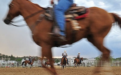 Matt Hinshaw/The Daily Courier<br>Contestants warm up their horses in a backstage arena 30 minutes before the start of Tuesday night's second performance of the Prescott Frontier Days World's Oldest Rodeo.