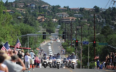 A motorcycle escort leads 19 hearses into Prescott Sunday, bringing the men of the Granite Mountain Hotshots back home. (Les Stukenberg/The Daily Courier file)