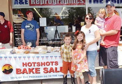 Courtesy photo<br> The Kleinman family operates a bake sale to benefit the Granite Mountain Hotshots' families in downtown Prescott July 5.