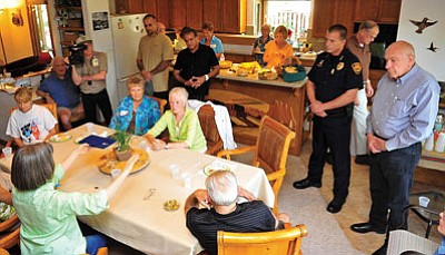 Matt Hinshaw/The Daily Courier<br> Former Prescott Police Chief Mike Kabbel and Prescott Mayor Marlin Kuykendall address homeowners in the Village subdivision' during the 2012 National Night Out. This year's event will take place Aug. 6.